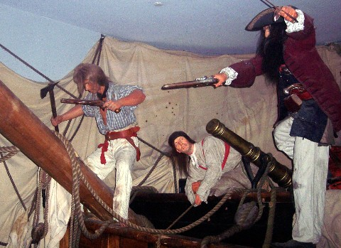 Photo of Captain Teach aka Blackbeard and his crew goes here.