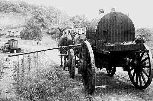 Photo of a fumigation wagon in 1905 goes here.