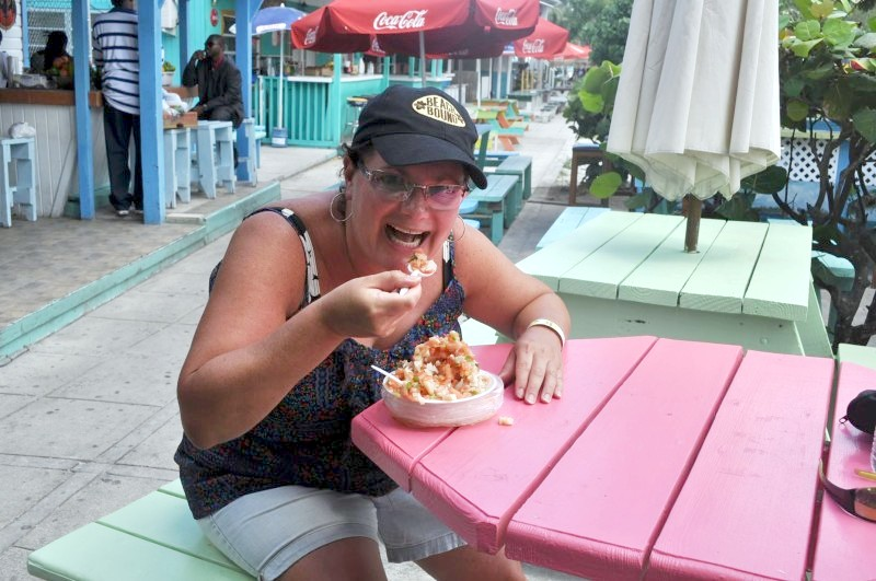 Lizz Dinnigan dines on fresh conch salad at Arawak Key, the Bahamas.*