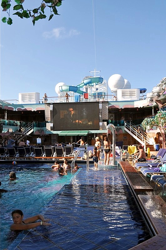 Photo of big movie screen above the main pool area goes here.*