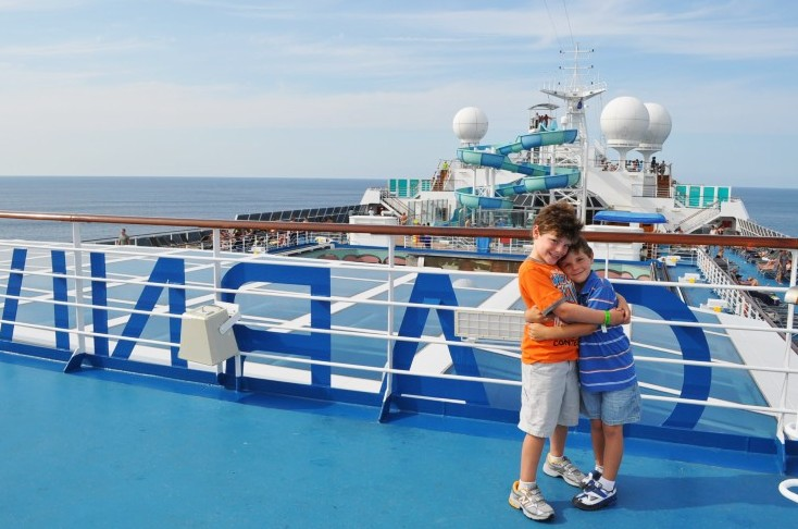 Photo of Jack and Casey Dinnigan atop Carnival Splendor goes here.*