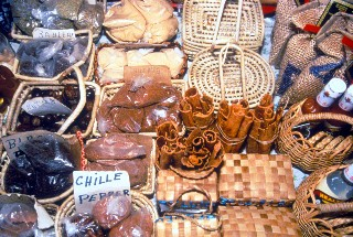 Photo of spices and baskets at the Castries market goes here.