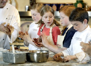 Photo of kids in a cooking class goes here.