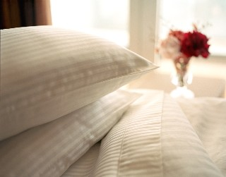 Photo of Holland America bed linens and pillows goes here.