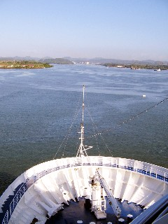 Photo of the bow of the Silver Shadow as it enters the channel to the Miraflores Locks goes here.