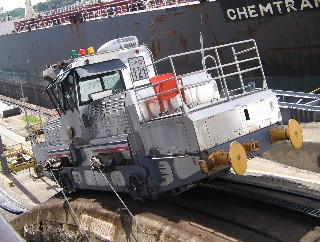 Photo of locomotive going up the Miraflores lock grade goes here.