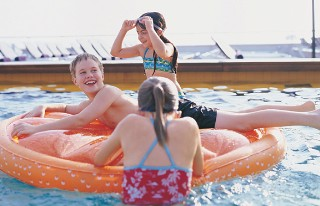 Photo of kids in a Holland America onboard pool goes here.