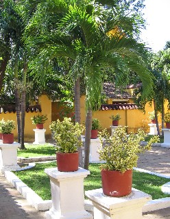 Photo of courtyard of Simon Bolivar hacienda goes here.