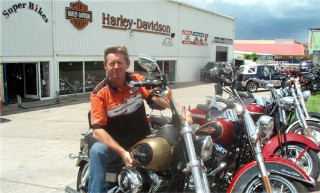Photo of Harley manager and bikes goes here.